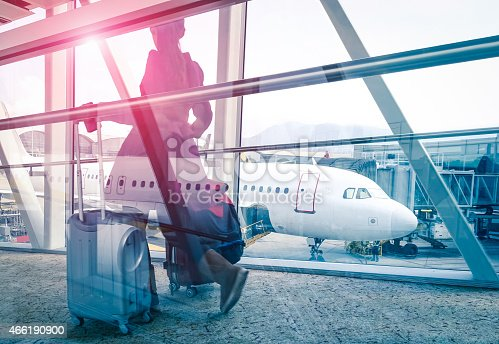 istock Woman at airport terminal gate on double exposure effect 466190900
