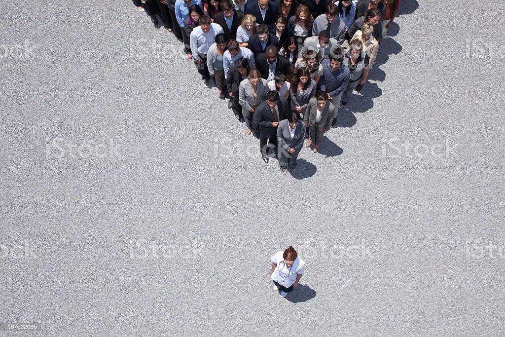 Woman at apex of crowd stock photo