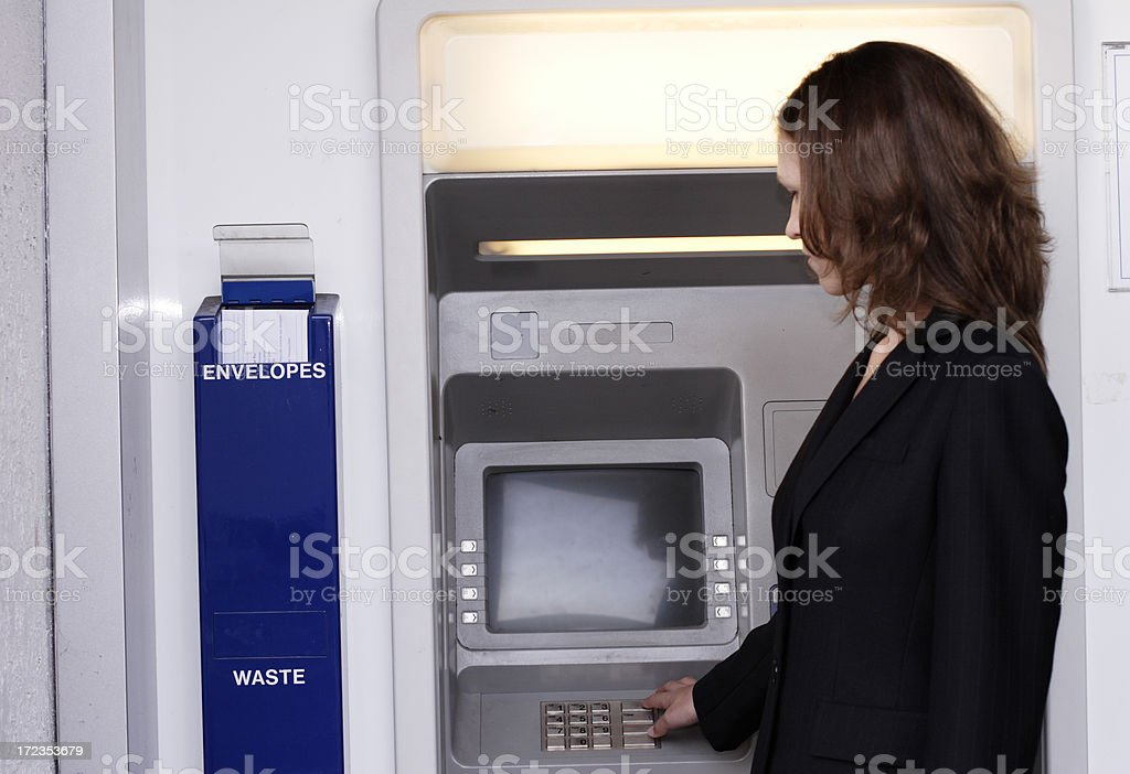 Woman at ATM royalty-free stock photo