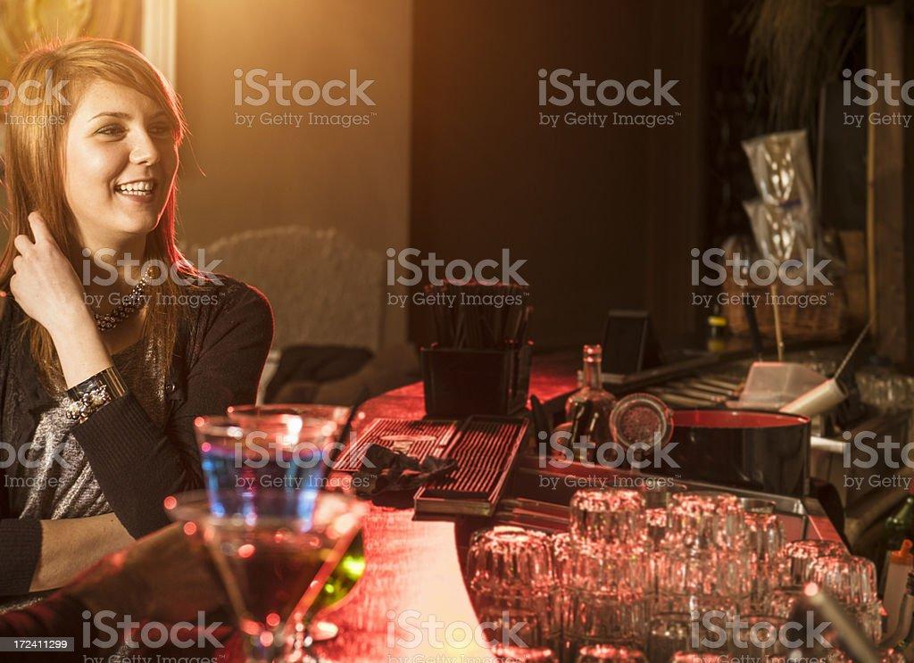 Woman at bar counter on a disco pub royalty-free stock photo