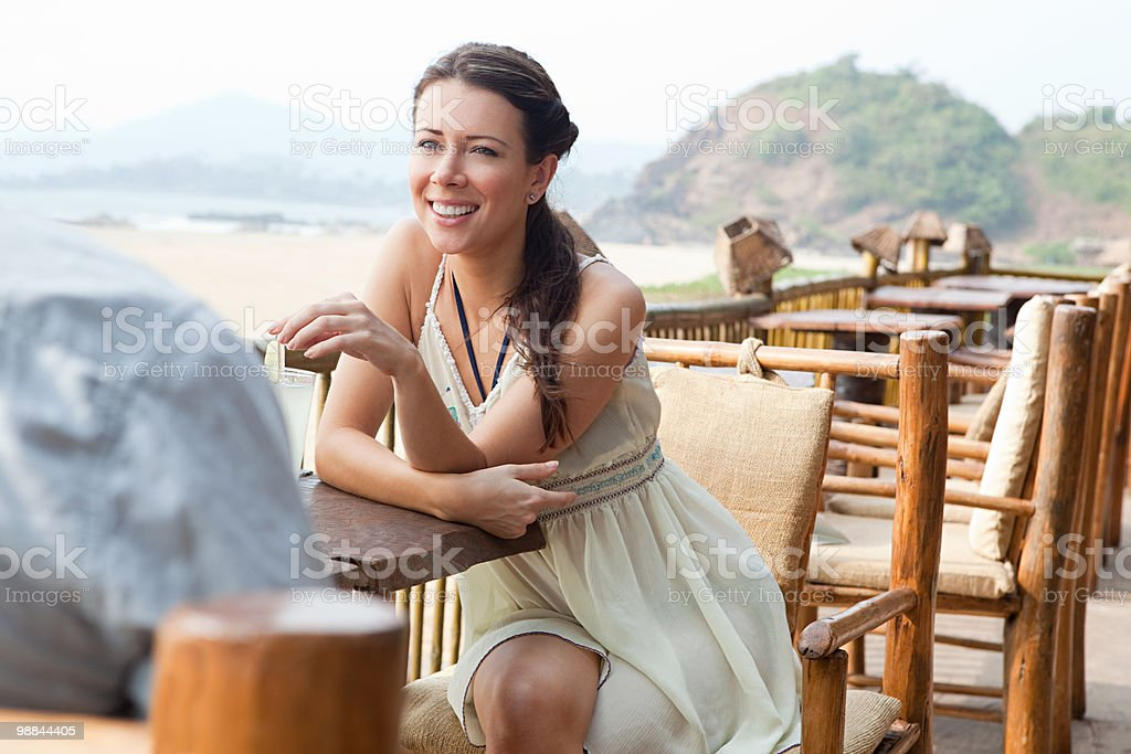 Woman at beach bar royalty-free stock photo