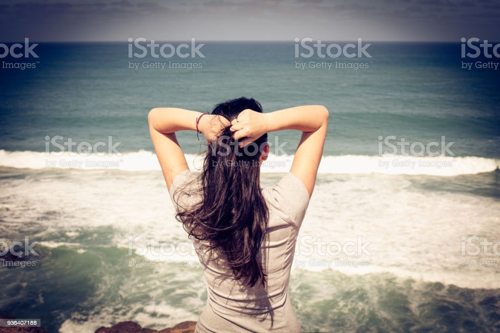 Woman at beach. Close up. From back. stock photo