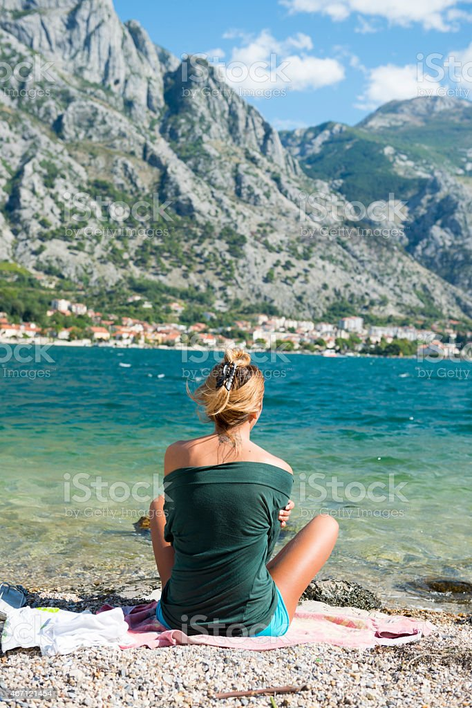 Woman at beach on Kotor Bay in Montenegro stock photo