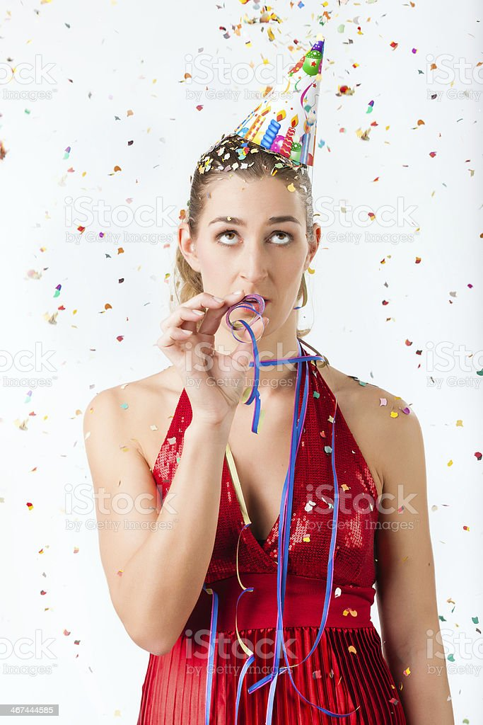 Woman At Boring Birthday Party With Streamer Royalty Free Stock Photo