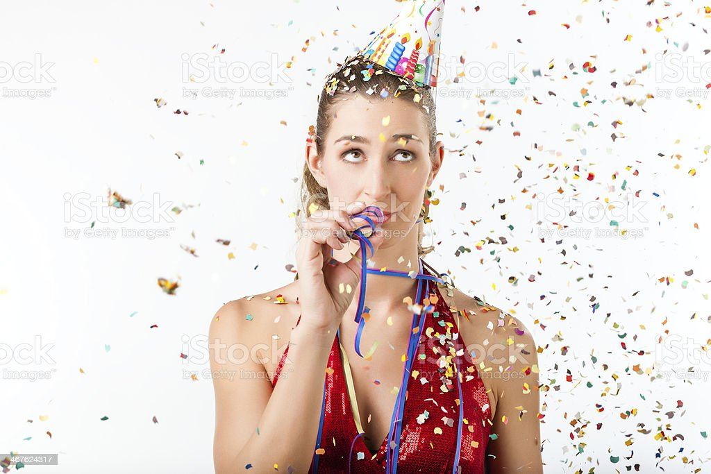 Woman at boring birthday party with streamer stock photo