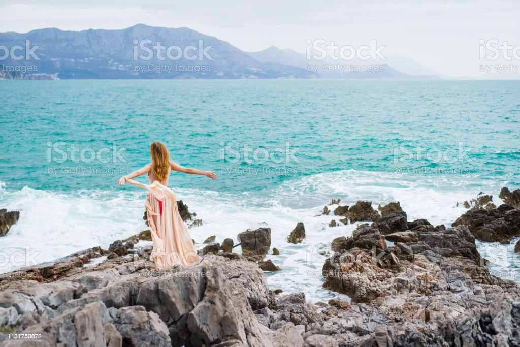 Woman at Budva coast стоковое фото