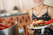 Close-up of unrecognizable woman seafood buffet