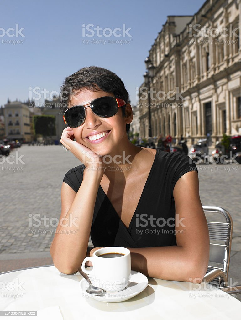 Woman at cafT table, royalty-free 스톡 사진