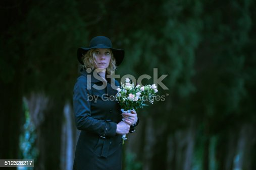 istock Woman at cemetery 512328217