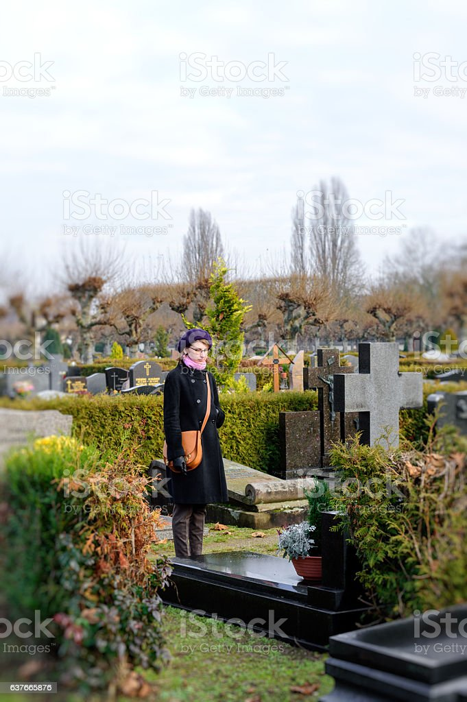 Woman at cemetery stock photo