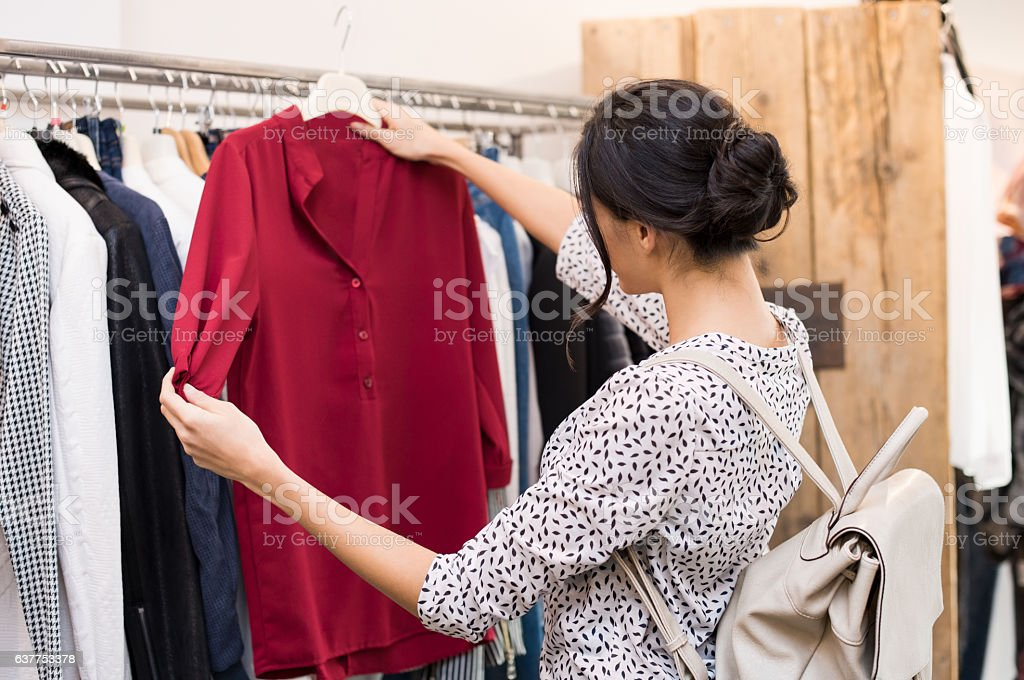 Woman at clothing store stock photo