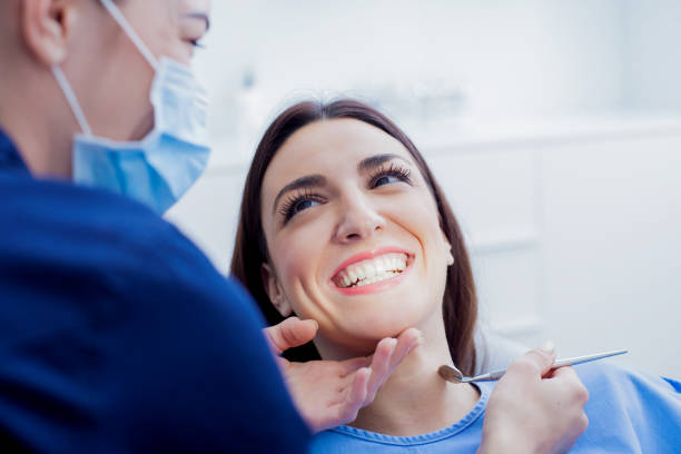 Woman at dentist Woman visiting her dentist dental health stock pictures, royalty-free photos & images