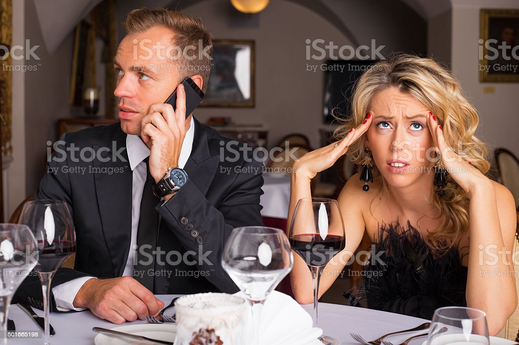 Woman at dinner date being annoyed stock photo