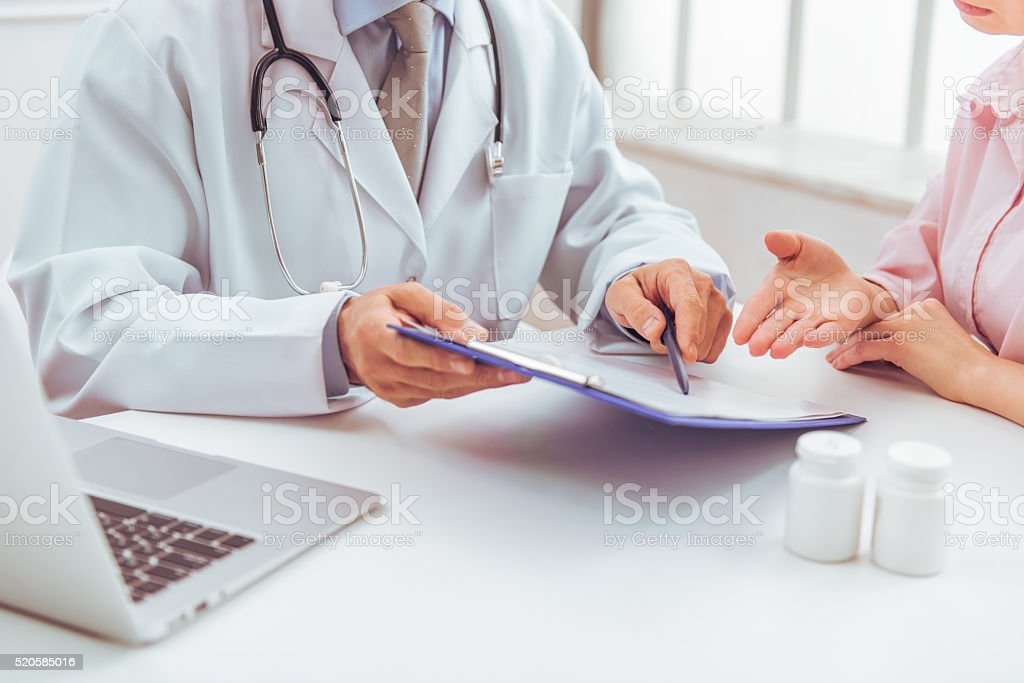 Woman at doctor stock photo