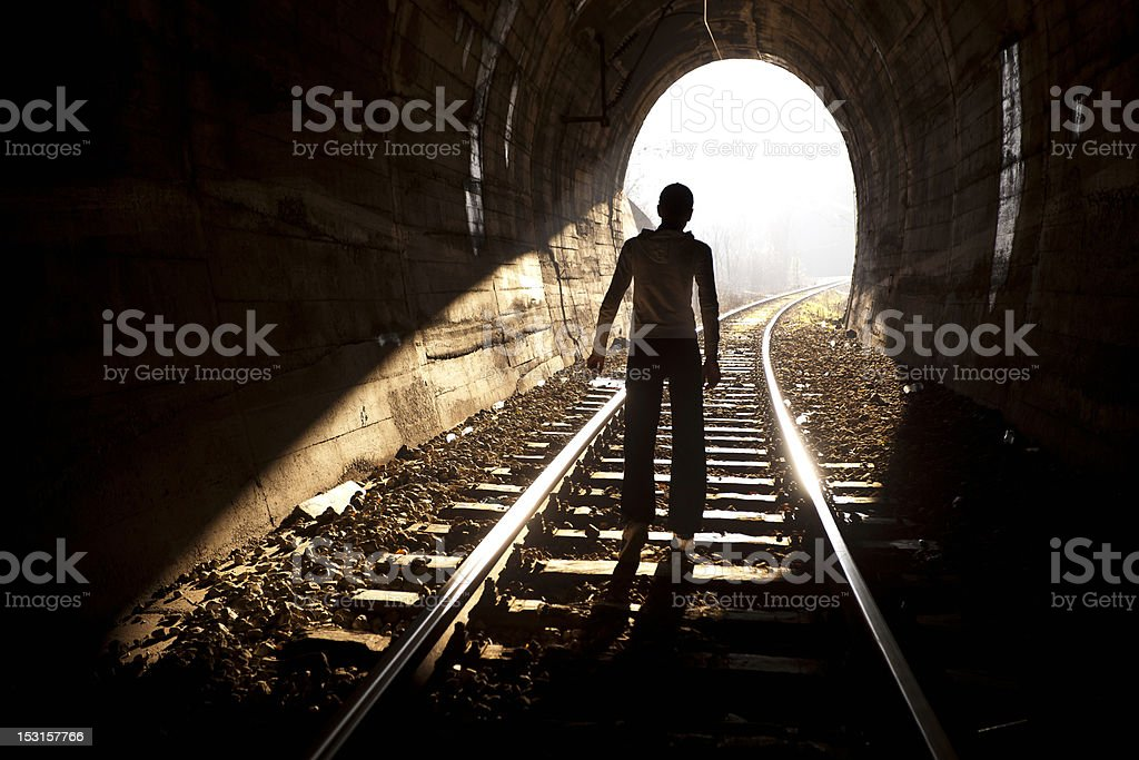 Woman at End of Tunnel - Exit royalty-free stock photo