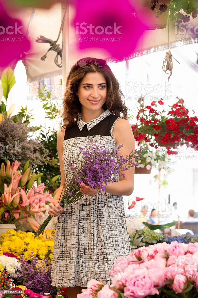 Woman at flower market stock photo