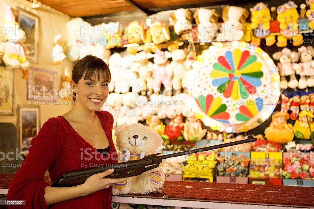 Woman at funfair rifle range stock photo