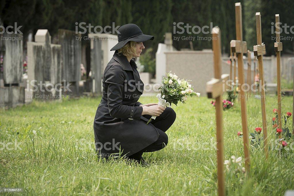 Woman at graveside stock photo
