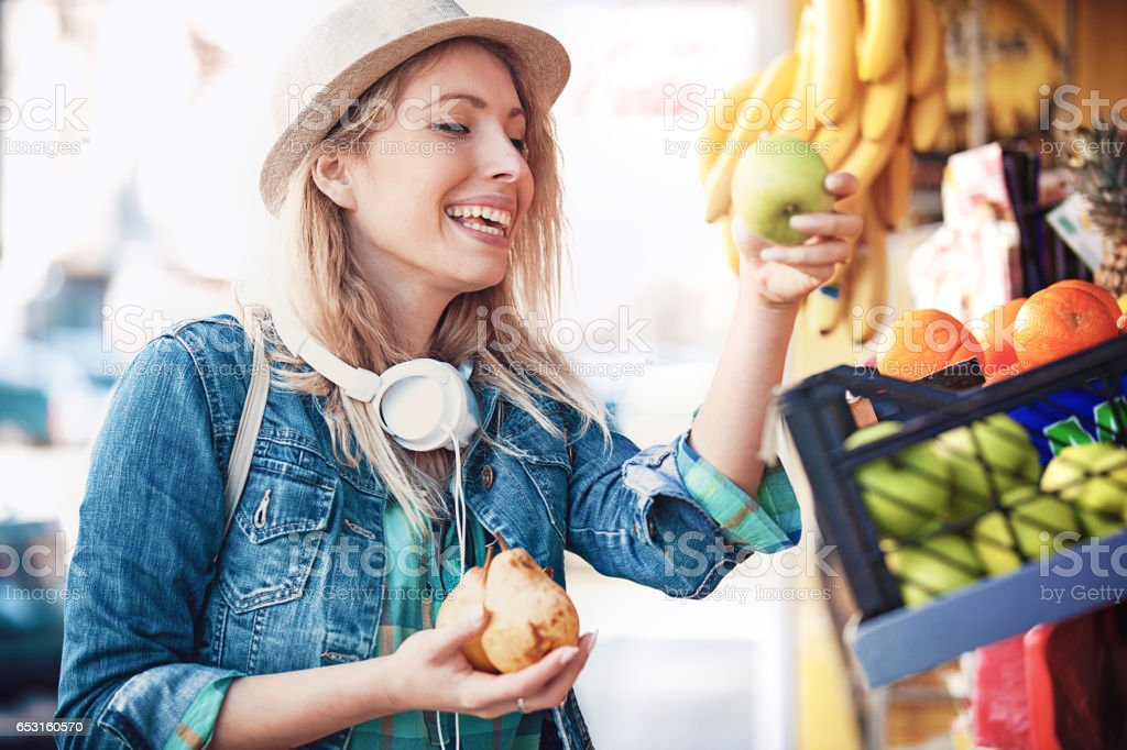 Woman at green market stock photo