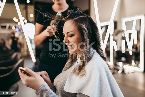 istock Woman at hair salon 1138252831