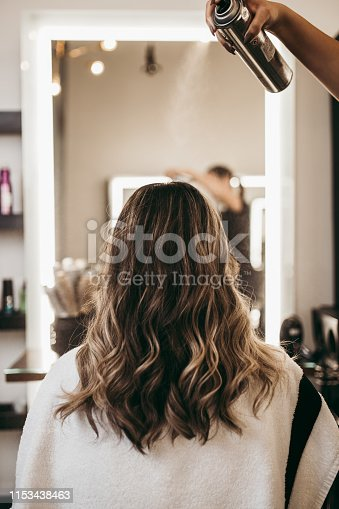 istock Woman at hair salon 1153438463