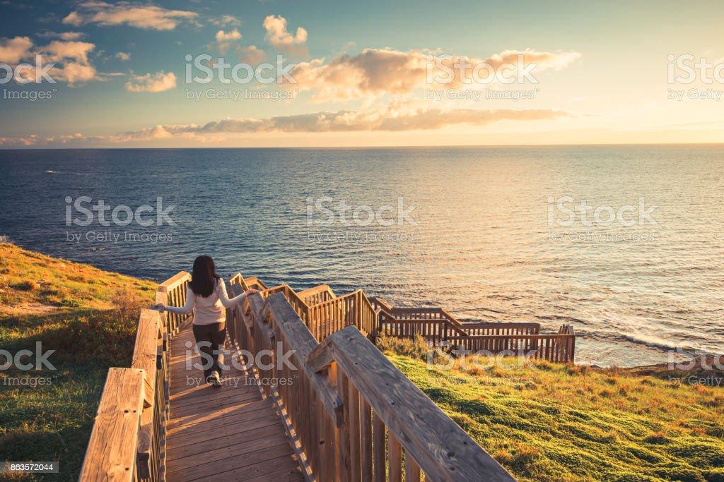 Woman at Hallett Cove boardwalk stock photo
