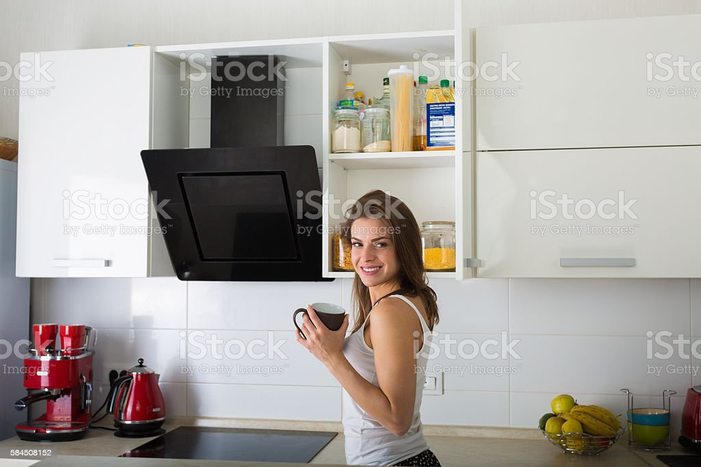 Woman at her kitchen in the morning stock photo