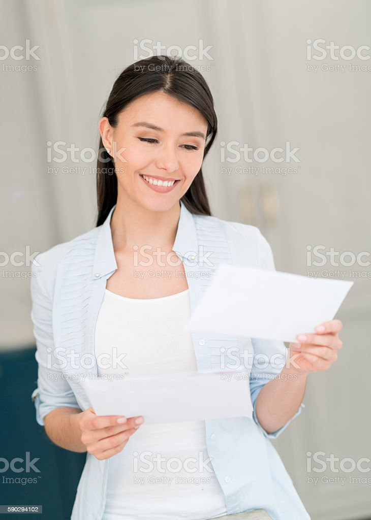 Woman at home getting the mail royaltyfri bildbanksbilder