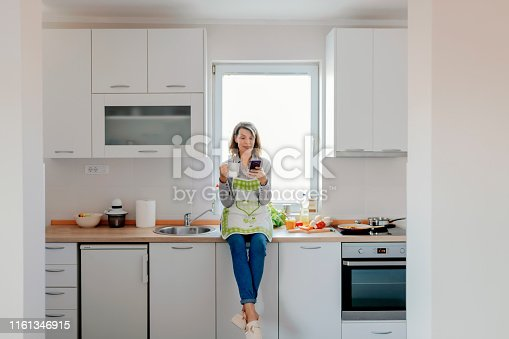638765726 istock photo Woman at home 1161346915