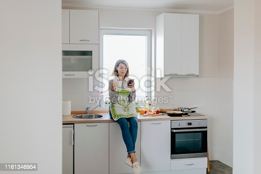 638765726 istock photo Woman at home 1161346954