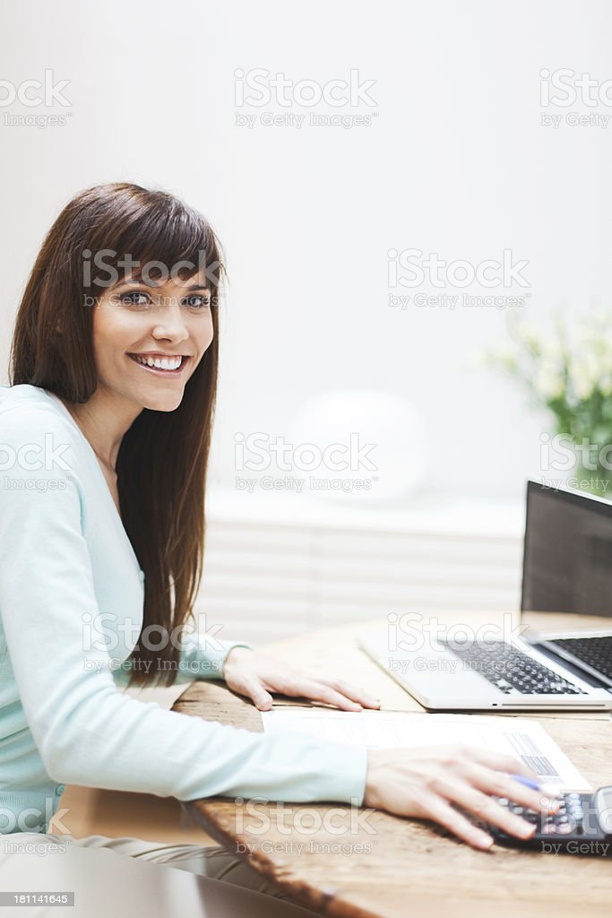 Woman at home working with her laptop. royalty-free stock photo