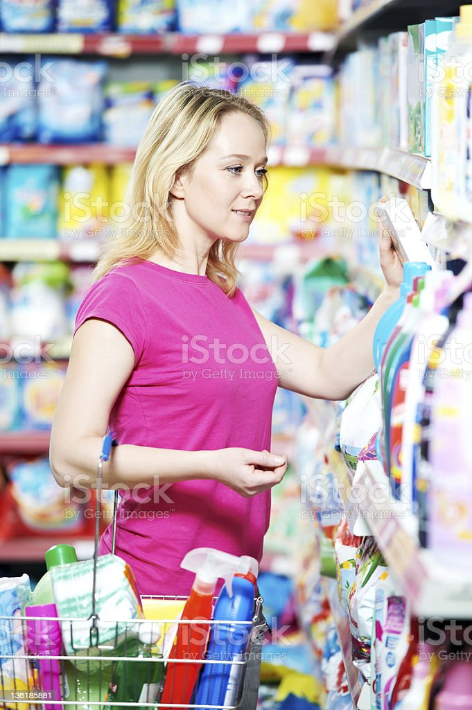 woman at household chemistry shopping stock photo
