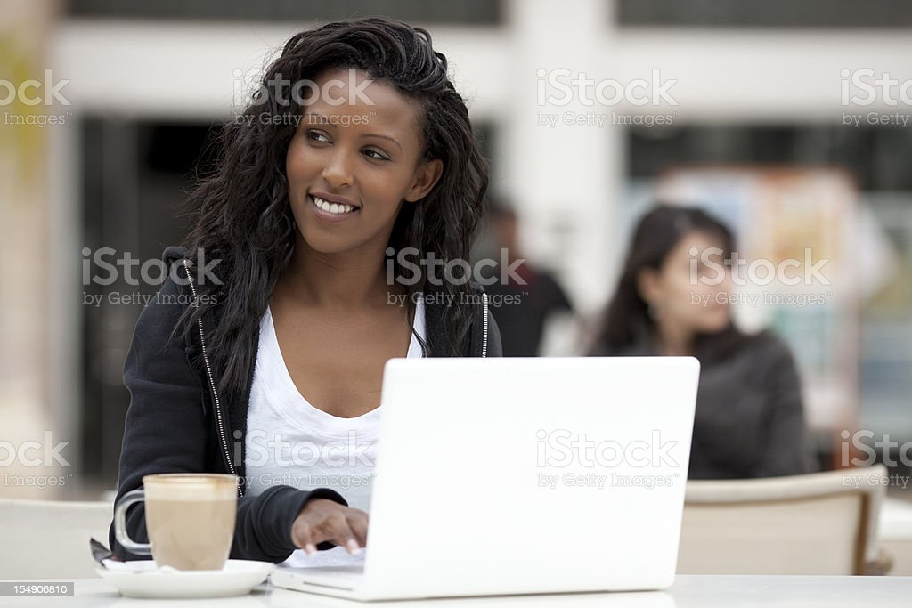 Woman at internet cafe. royalty-free stock photo