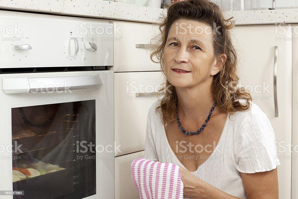 Woman at kitchen. stock photo