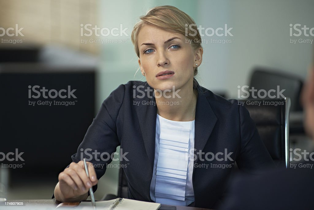 Woman at meeting stock photo
