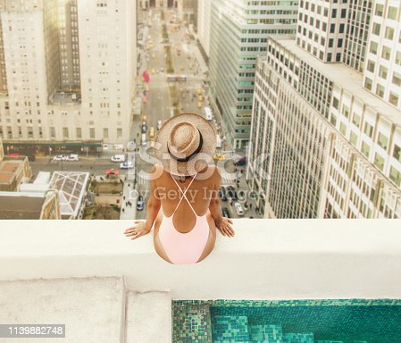 istock Woman at New York Rooftop 1139882748