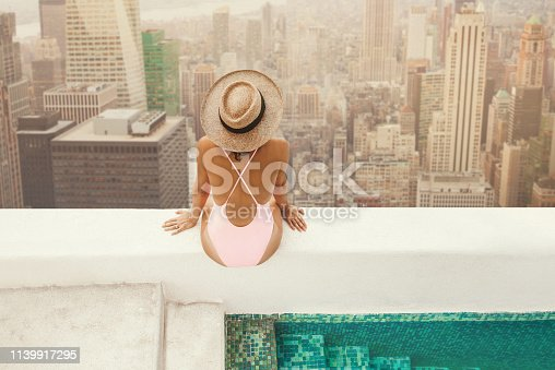 istock Woman at New York Rooftop 1139917295