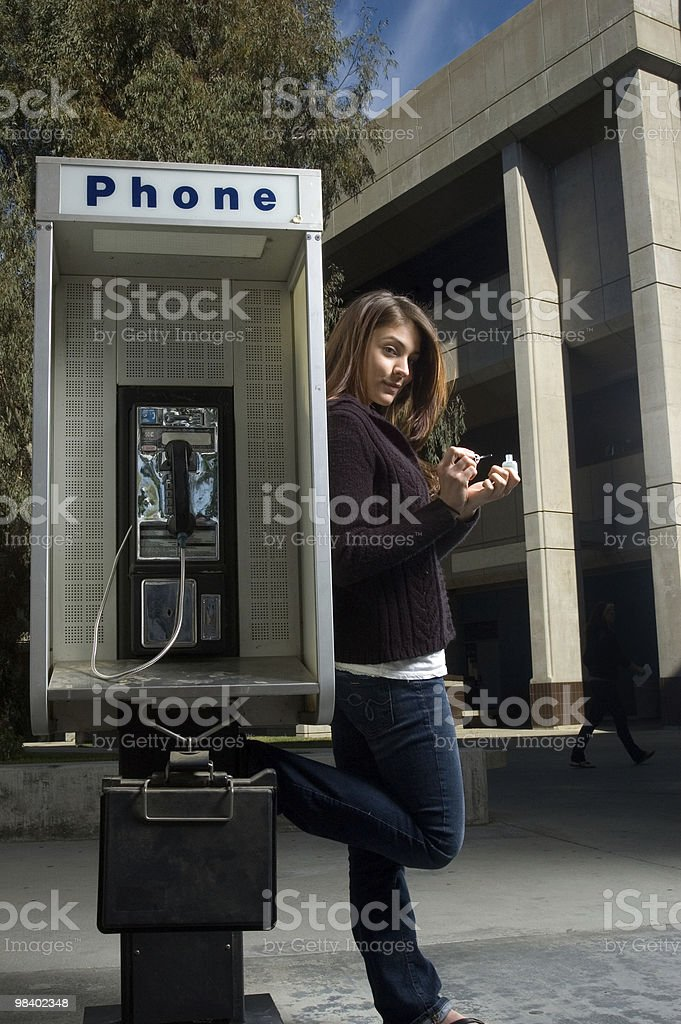 Woman at Payphone royalty-free stock photo