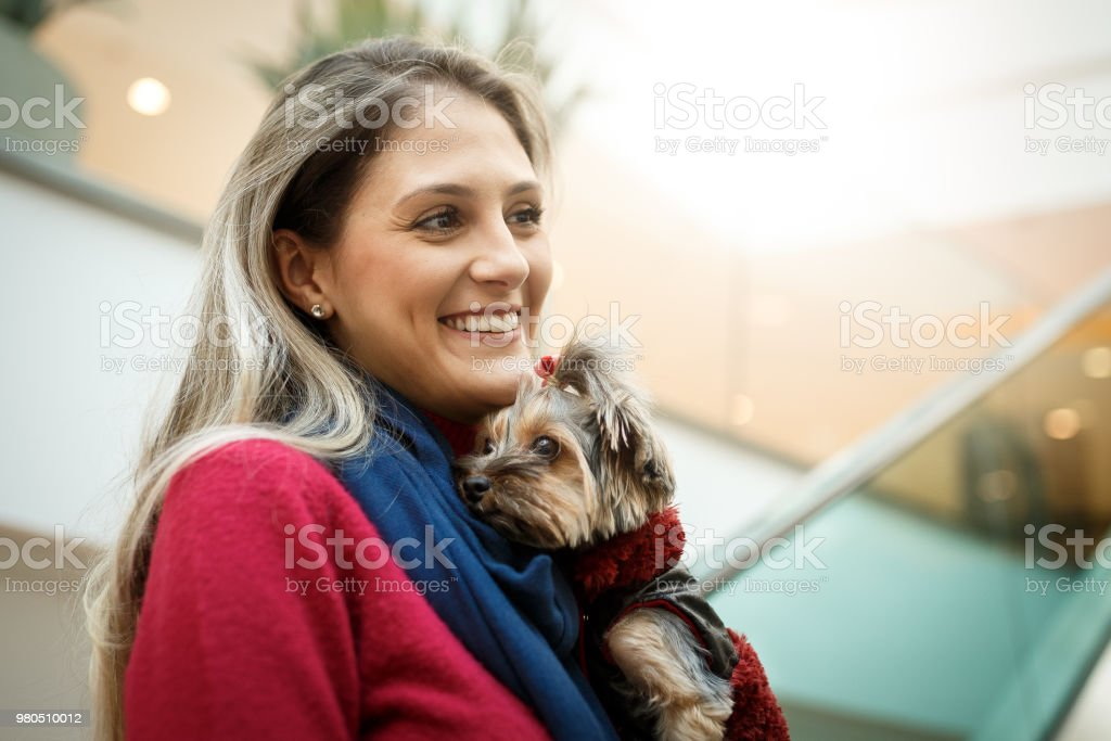 Beautiful woman at pet friendly shopping with her dog