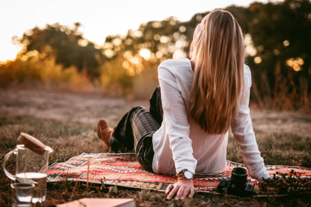 Woman at picnic stock photo