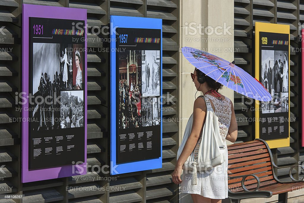 Woman at Queen's Diamond Jubilee Exhibit stock photo