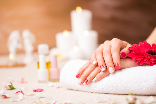 istock Woman at saloon with pretty manicure 513380556