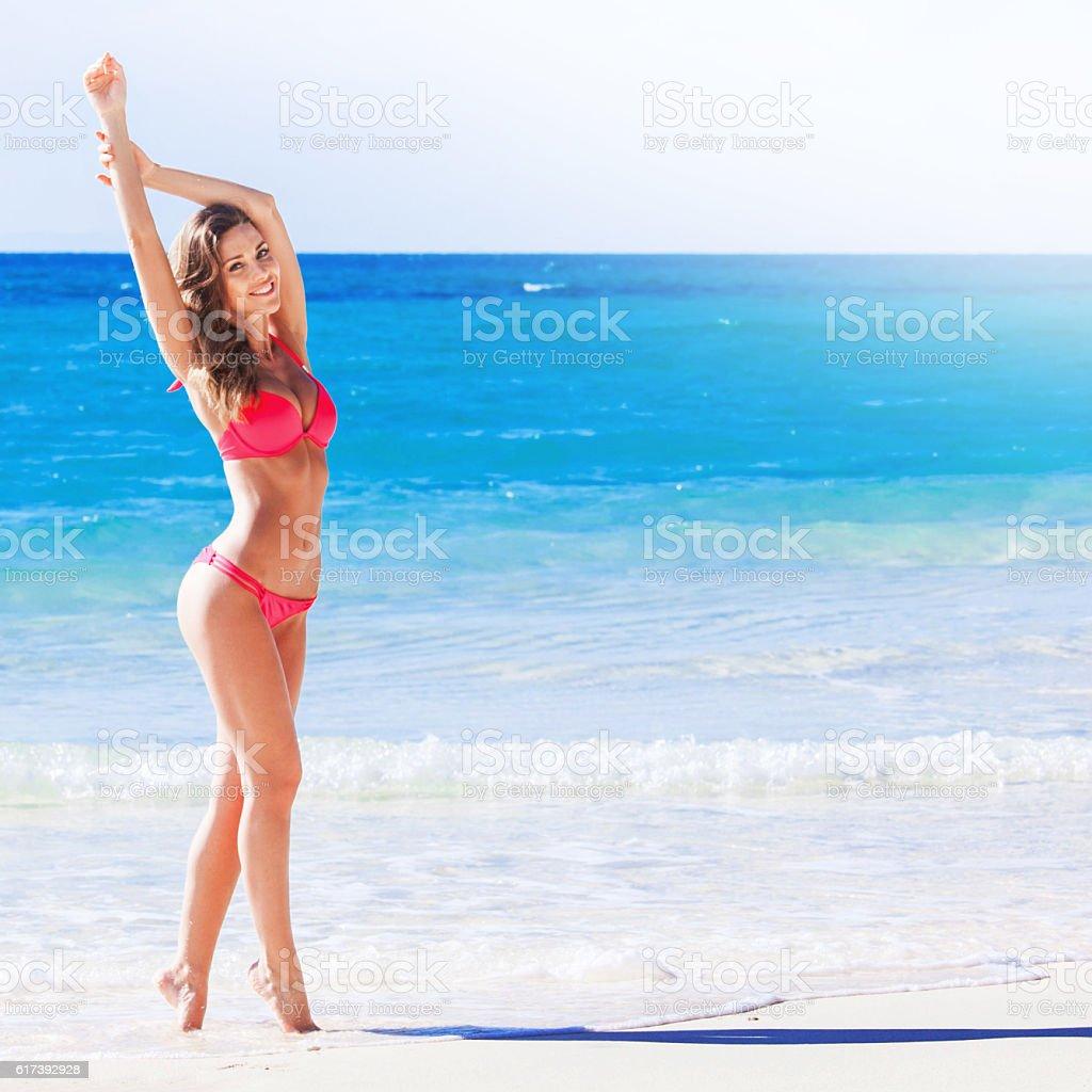 Woman at sea beach stock photo
