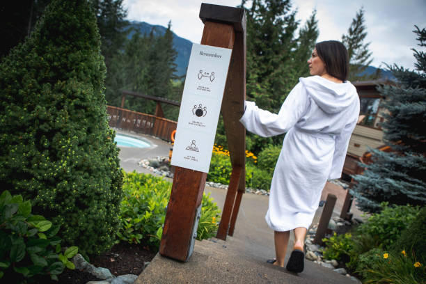 Woman at spa follow signage to avoid covid-19 pandemic.