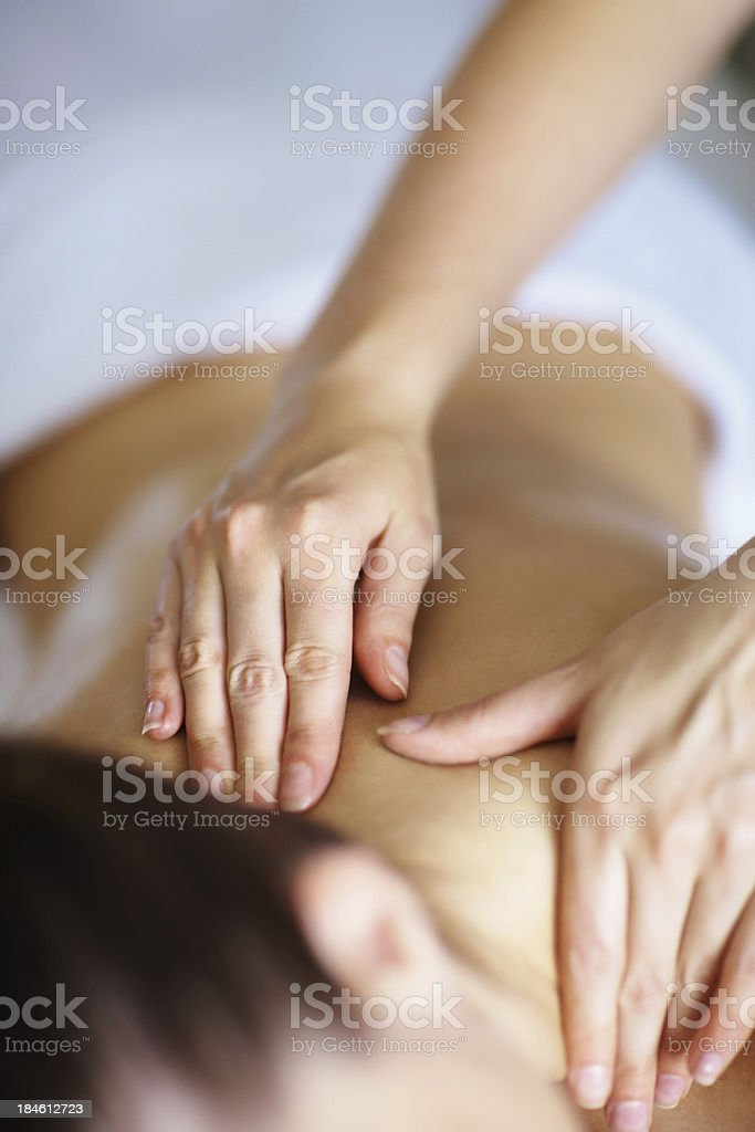 Woman at spa receiving massage royalty-free stock photo