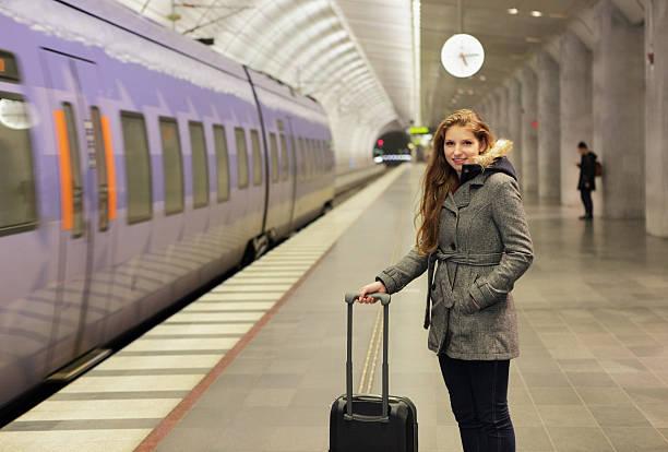 woman at station with train - skåne bildbanksfoton och bilder