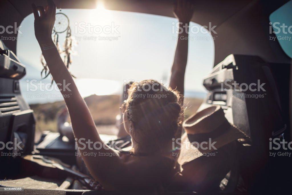 Beautiful woman chilling in car trunk