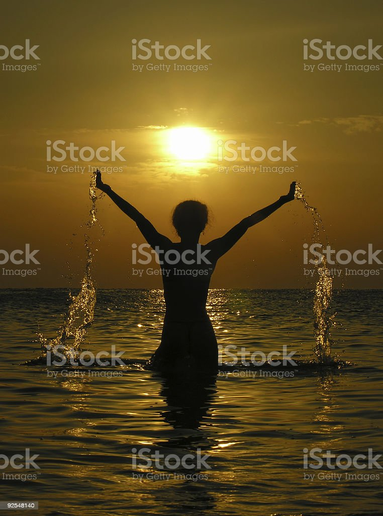 woman at sunrise with drops of water royalty-free stock photo