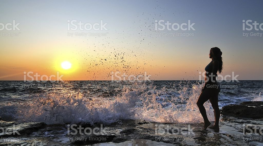 Woman at sunset royalty-free stock photo