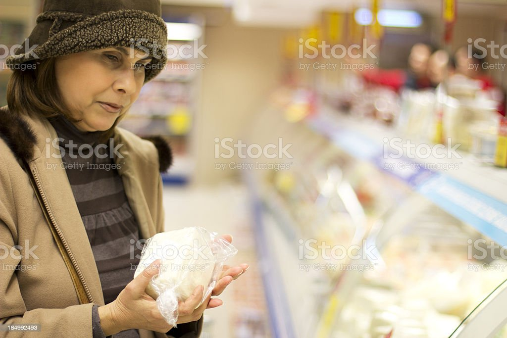 Woman at supermarket royalty-free stock photo